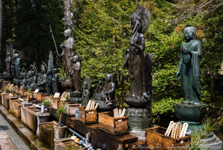 Statues depicting Mizo - visitors would use the ladles shown and throw water on the statues before praying.