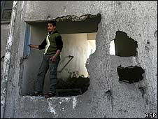 A Palestinian boy inspects the damage to a United Nations school in Rafah