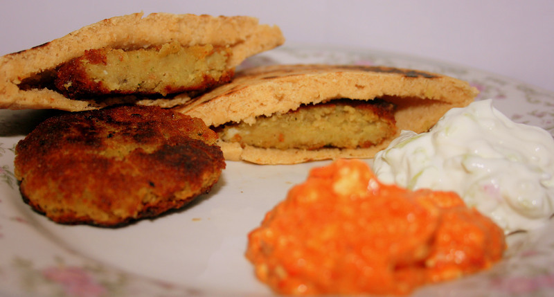Falafel served in pita pockets, with roasted red pepper dip and tzatziki