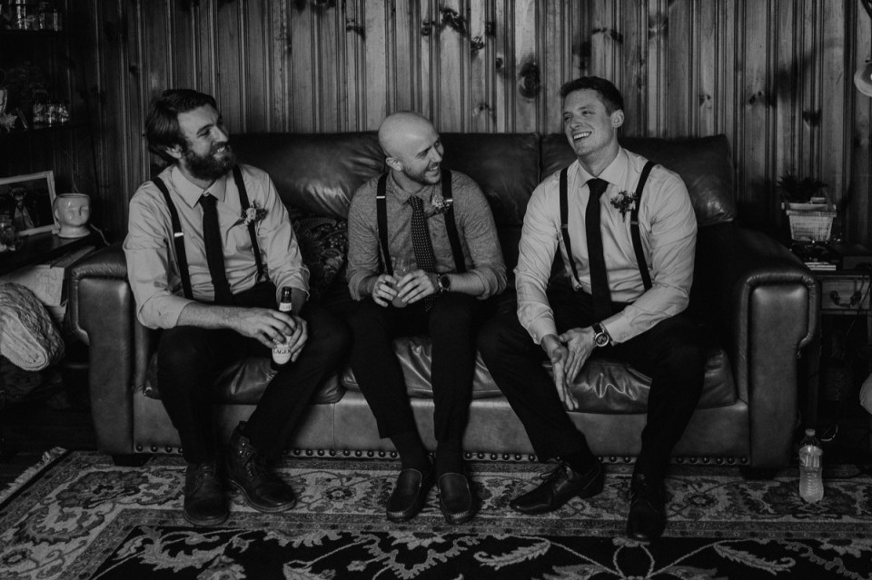 Groom and his groomsmen laughing.