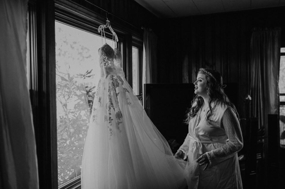 Bride admiring her dress before her Asheville elopement.