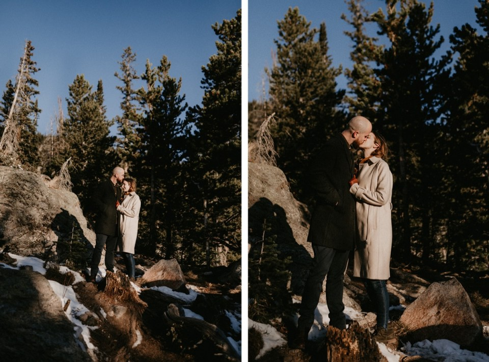 Man giving his fiancée forehead kisses during their Rocky Mountain National Park engagement photos.