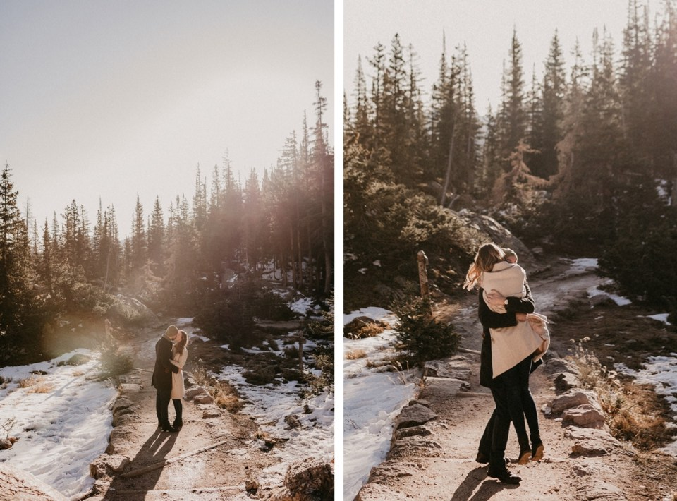 Man picking up fiancée in excitement during their Rocky Mountain National Park engagement photos.