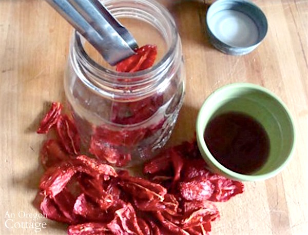Drying Tomatoes-dipping in vinegar
