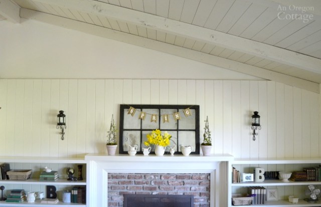 Simple White Pitcher Spring mantel with bookcases