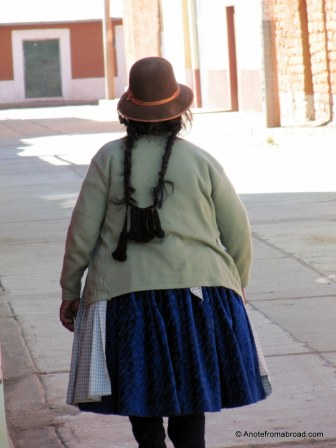Long braids and derby hat