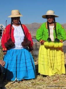 Layered wool skirts, long braids, derby hats