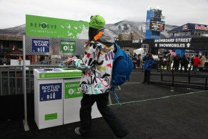 A fan recycling at one of the REPREVE recycling stations at the X Games