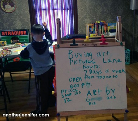 """We've turned part of our second floor into an art studio and """"store."""" G made the sign with Biz's direction."""