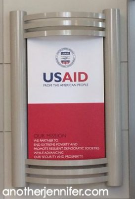 I had to go through two security checks and be escorted up to the USAID office.