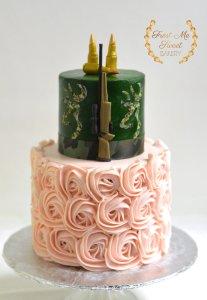 Rifles or roses gender reveal cake