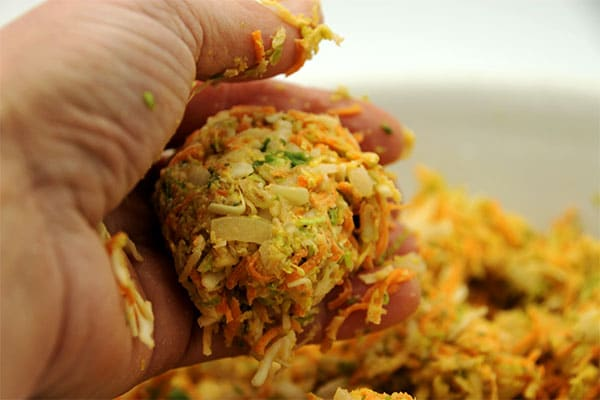 Veggie balls being formed with hand