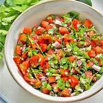 DIY pico de gallo in bowl on plate with jalapeno and coriander.