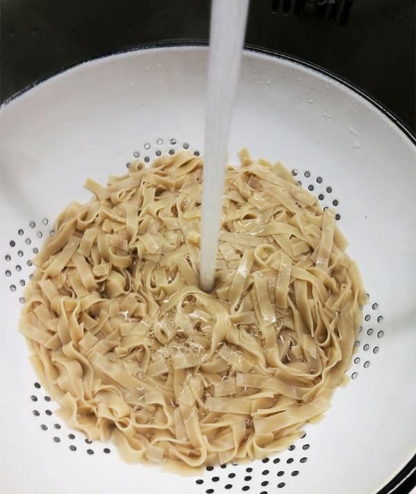 sunshine tofu & noodles rinsing rice noodles