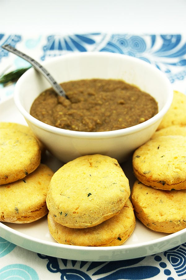 vegan biscuits on plate with lentil gravy in bowl.