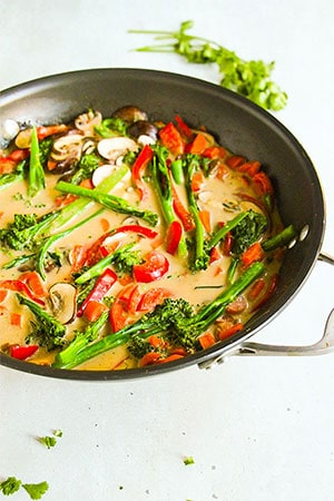 veggie Thai red curry in wok with coriander in background