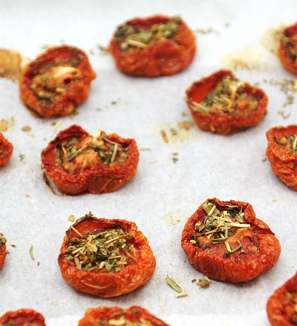 oven-dried tomatoes on baking tray with parchment paper