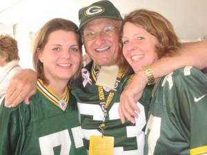 This is Packer legend Fuzzy Thurston choking Kathy and me in one of his famous bbear hugs. Kathy and I have been going to Packer games together for well over 20 years.