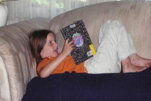 Here is Molly at six-years old enjoying a summer afternoon reading.
