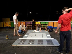 The cast of How to Succeed at Business Without Really Trying pitched in to help paint sets the weekend before the show opened. Community actors are very versatile.