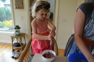 Erin went to work mashing the raspberries. Next time Molly makes the cupcakes, she plans to either leave the raspberries whole, or strain them after she mashes them,