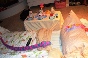 This is the bed Erin made up for her 6-5 cousin Charlie. The pink and purple snake freaked him out a little, but he enjoyed the tea party.