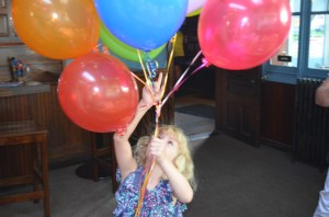 Someone put Erin in charge of the balloons and we would have lost her, Winnie the Pooh like, had a decent gust of wind caught her bouquet. She took her balloon responsibility  very seriously.