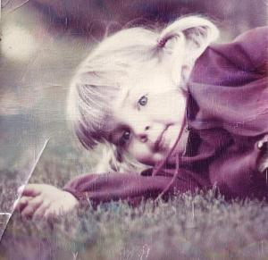 She sprouted her eyebrows early. Here's three-year old Kathy, photographed by her dad.