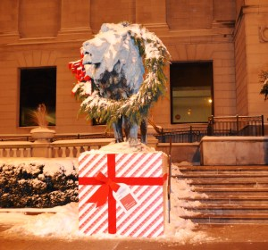A snowy but festive lion guards Chicago's Art Institute.