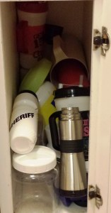 "My well-organized water bottle cabinet has become a plastic graveyard, full of old water pitchers and giant Country U.S.A. mugs. I am currently using a ""Sheriff"" water bottle, which may or may not discourage pilfering."