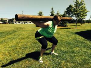 Sandy doing squats with a log