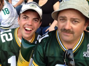 Aaron and his dad at the Packer game