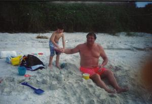 Charlie and dad on the beach