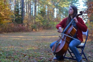 Molly and her cello in the woods