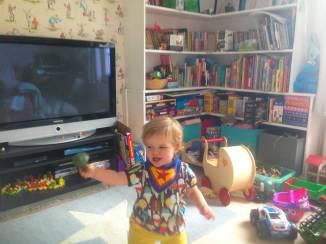 Eva brandishes broccoli in the playroom