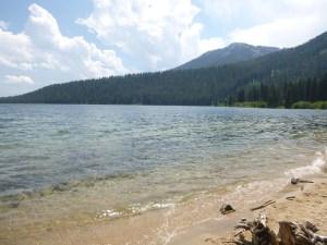 White sandy shore of Phelps Lake, Grand Teton National Park, WY