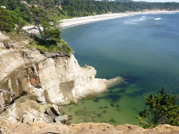 Clear green shallows in sandstone cove, Pacific Coast, Oregon