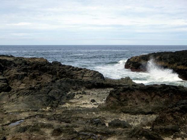 Spray on jagged basalt, Devil's Churn, Pacific Coast, Oregon