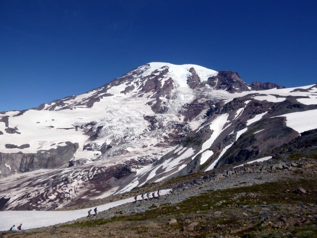 View of the mountain from the highest point I travelled.  You can see a mountain climbing expedition taking the spur up to the ice. Mount Rainier National Park, WA