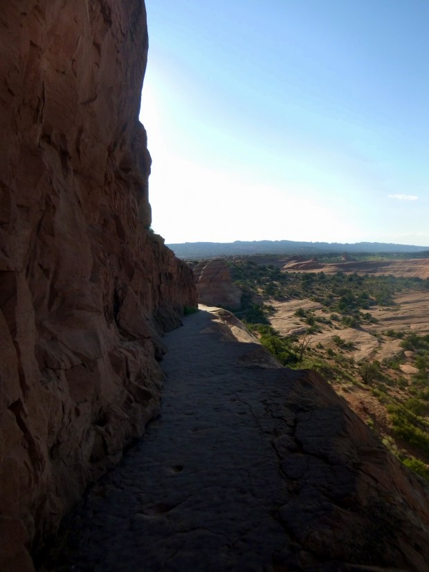 Rock ledge trail leading to Delicate Arch (the only shaded 200 yds of the trail), Arches National Park, Utah