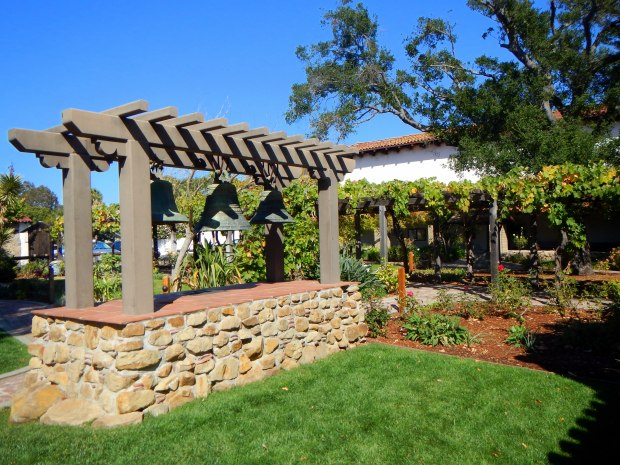 Courtyard and gardens with bells, Mission San Luis Obispo, California