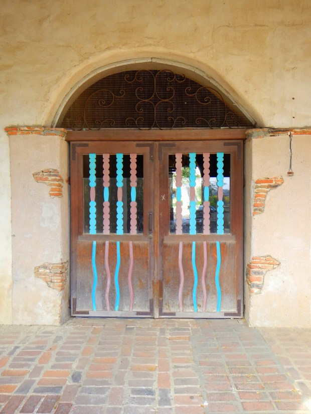 Hand-painted askew door in arcade, Mission San Miguel Archangel, California