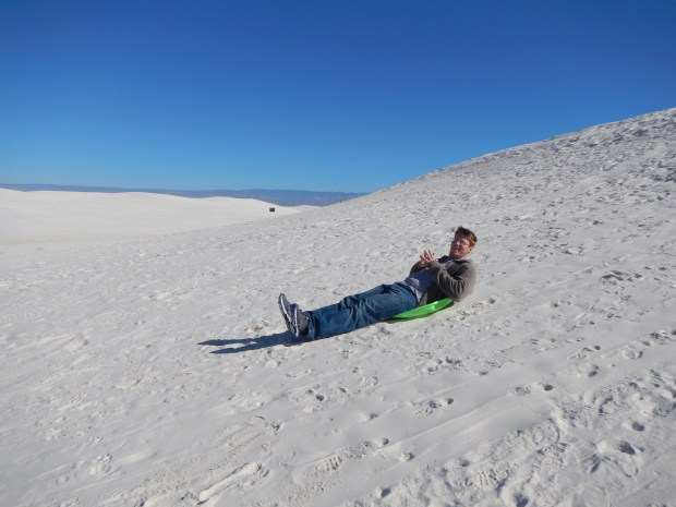 Blake going nowhere fast on a sloping hill, White Sands National Monument, New Mexico