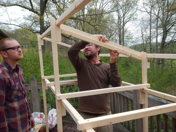 Jonathan and Daniel fitting the angles on the roof beams, Jasper, Tennessee