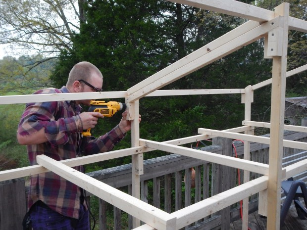 Daniel drilling in supports for roofing, Jasper, Tennessee