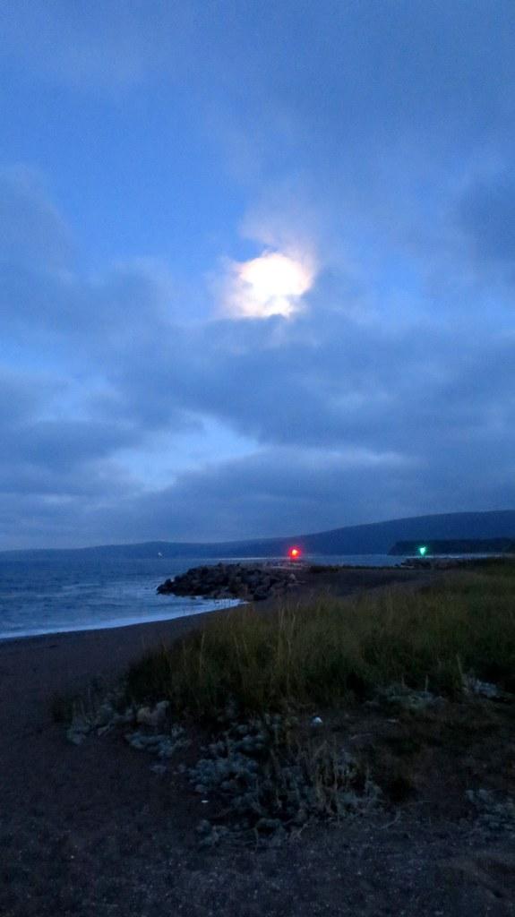 Moon over the entrance to Dingwall Harbor, Cape Breton Island, Nova Scotia, Canada