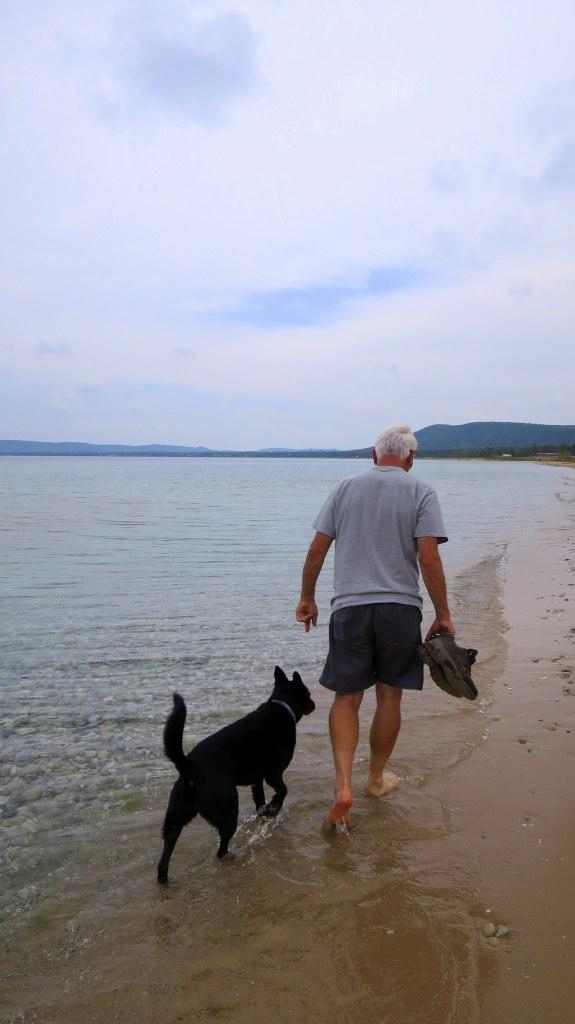 Tom and Abby walking on beach, Sleeping Bear Dunes National Lakeshore, Michigan