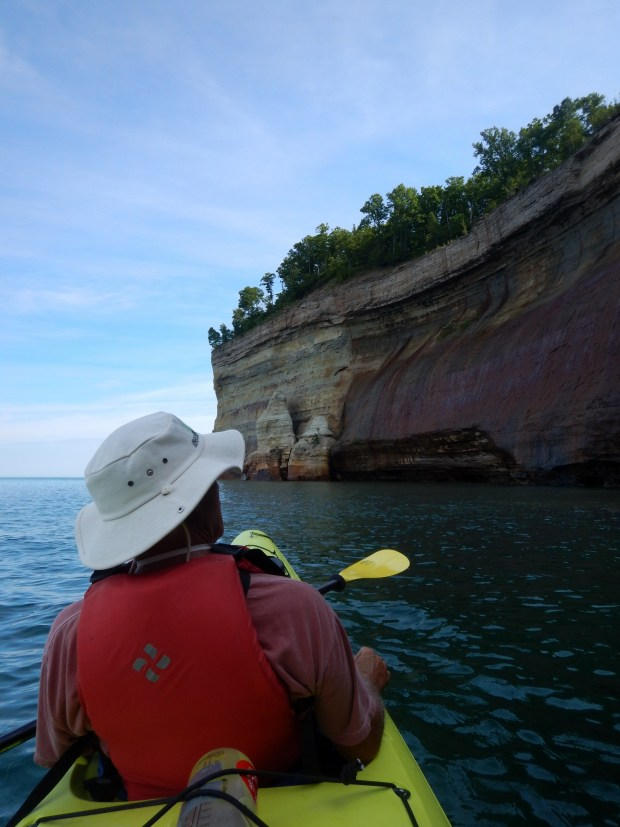 Tom looking up at mineral stains, Pictured Rocks National Lakeshore, Michigan