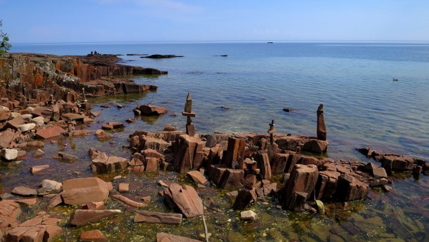 People putting things on top of other things plus some neat vertical basalt columns, Artists' Point, Grand Marais, Minnesota