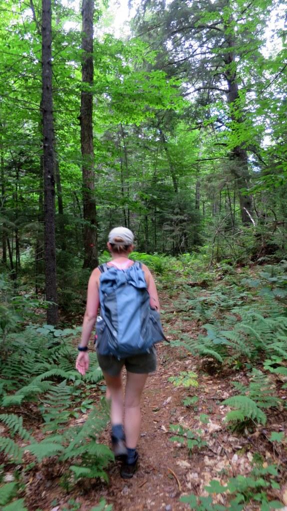 Rachel hiking on trail to Good Luck Lake, Adirondacks, New York